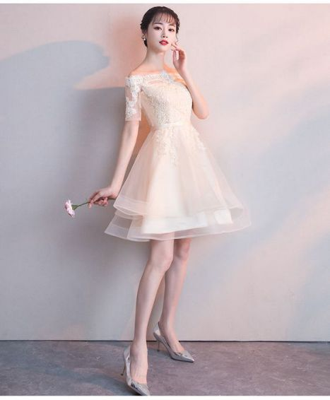 Chiếc đầm dạ hội màu trắng dáng ngắn trẻ trung năng động - Mẫu 5