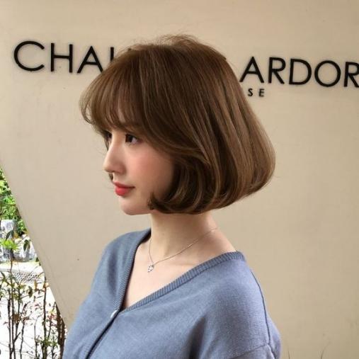 Tóc nữ ngắn xoăn cụp đuôi chữ C nắm bắt trend - Hình ảnh số 2